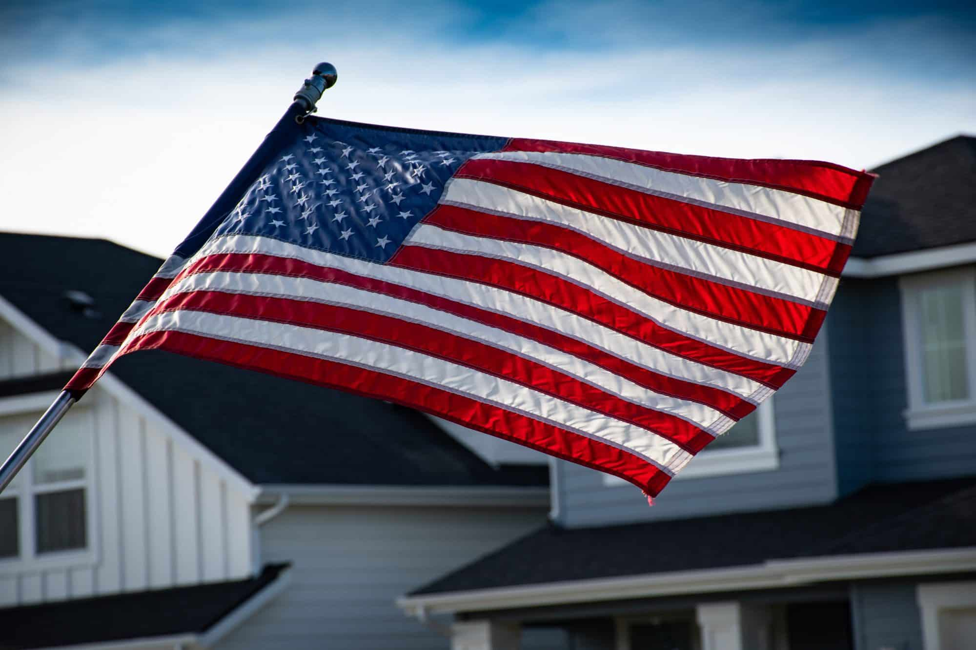 American Flag with VA Homes behind it