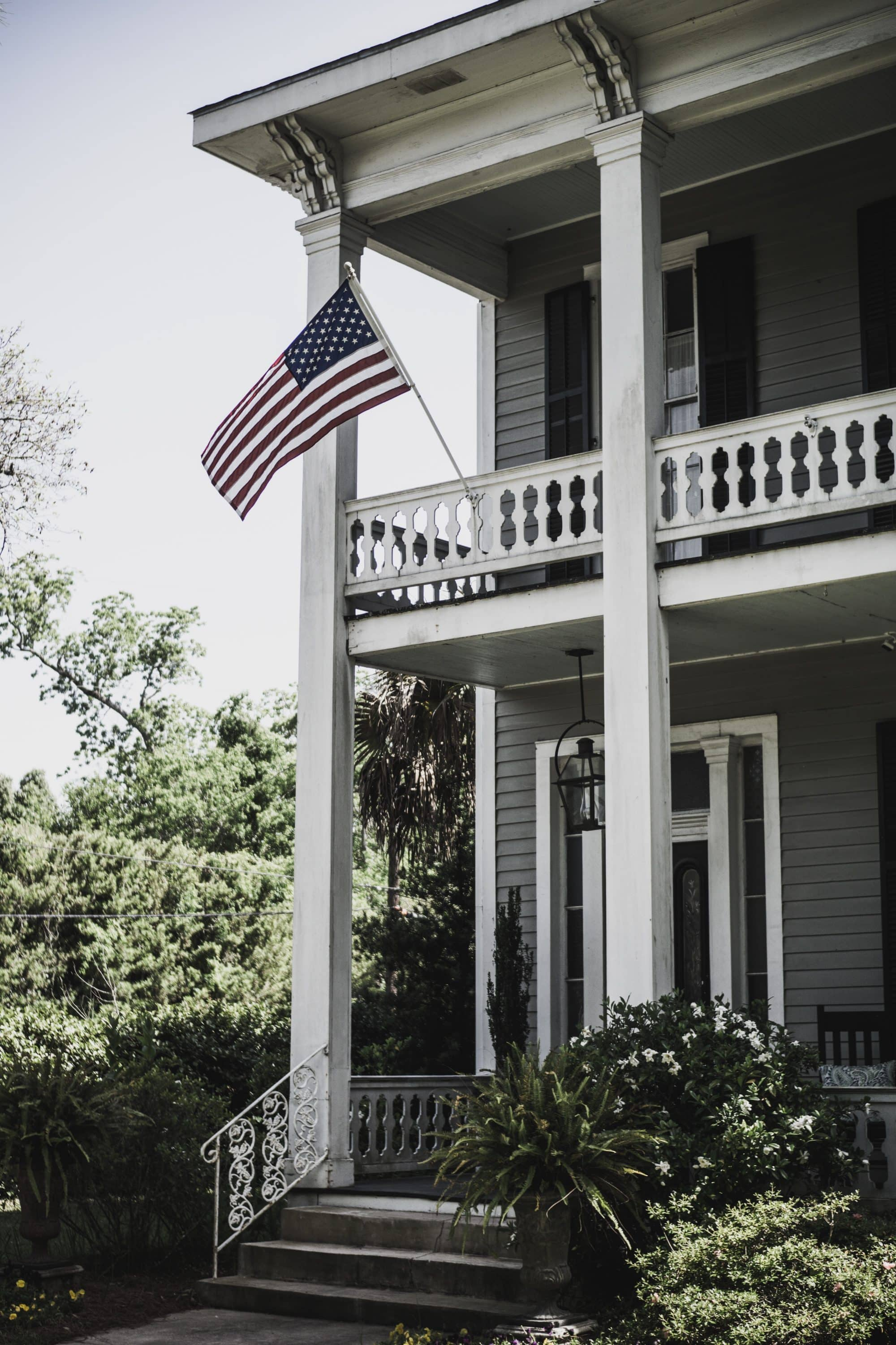 Two Story Colonial House with American Flag