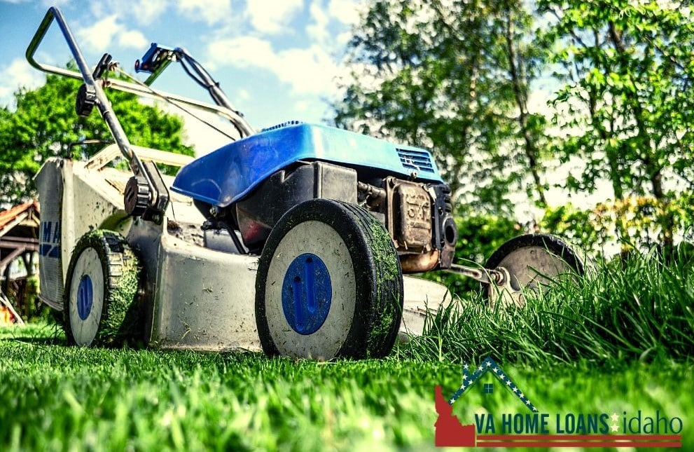 Blue lawn mower mowing grass