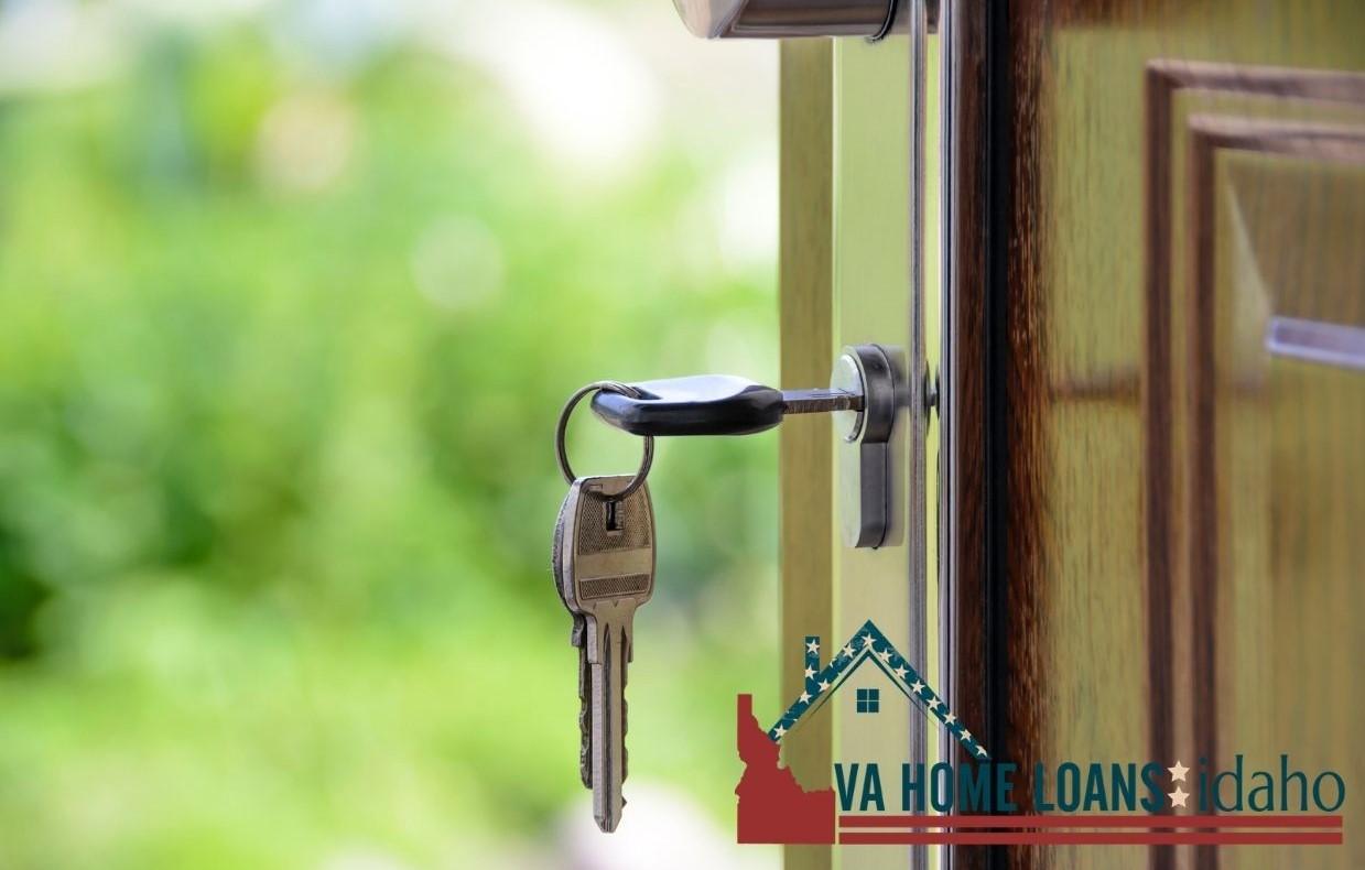 Open wood door with a set of keys in the lock